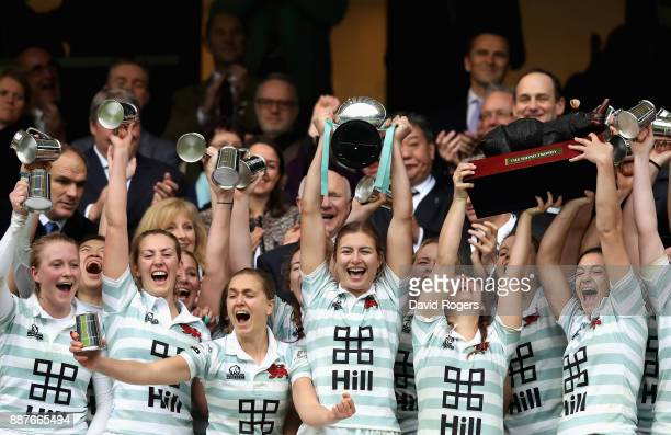 Lara Gibson of Cambridge and her team mates celebrate as they lift the trophy following victory in the Oxford University vs Cambridge University...