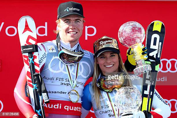 Lara Gut of Switzerland and Aleksander Aamodt Kilde of Norway win the SuperG crystal globes during the Audi FIS Alpine Ski World Cup Finals Men's and...