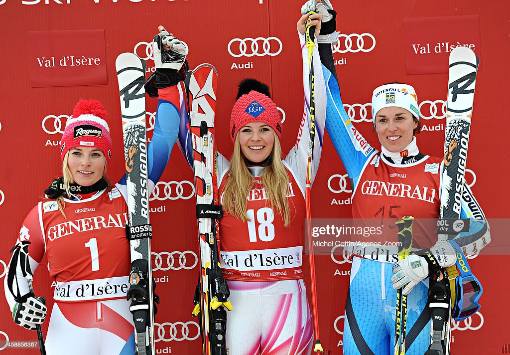 Lara Gut of Switzerland takes 2nd place, Maria Pietilae-Holmner of Sweden takes 3rd place, Tina Weirather of Liechtenstein takes 1st place during the Audi FIS Alpine Ski World Cup Women's Giant Slalom on December 22, 2013 in Val d'Isere, France.