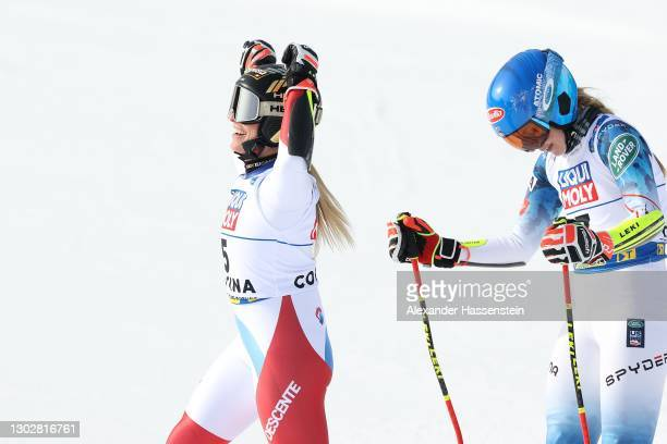 Lara Gut-Behrami of Switzerland celebrates at the finish after she wins Gold next to Mikaela Shiffrin of the US who wins the Silver after the FIS...