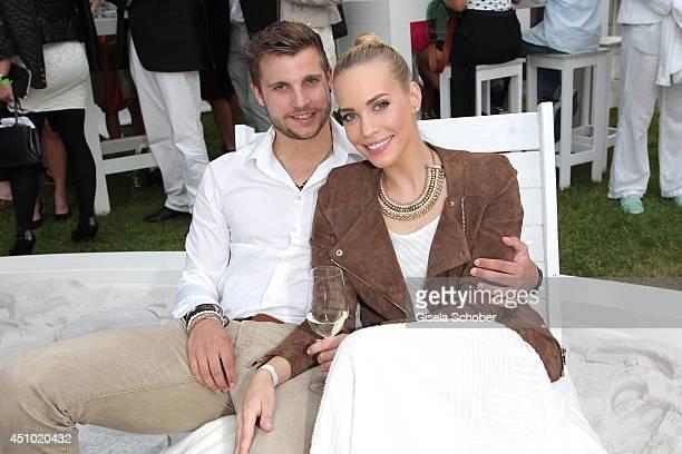 Lara Isabelle Rentinck and boyfriend Robert Gundlach attend the Raffaello Summer Day 2014 at Kronprinzenpalais on June 21 2014 in Berlin Germany