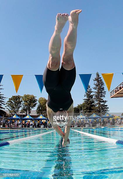 Lara Jackson stretches into the water to start the last heat of the womens 50 meter freestyle prelims at the XLIII Santa Clara International...