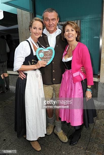 Lara Joy Koerner and her husband Heiner Pollert and Countess Gitta Lambsdorff attend the Tiffany Wiesn in front of the Tiffany shop before the...