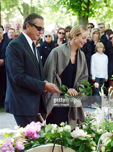 Lara Joy Koerner and her husband Heiner Pollert attend the funeral of German actress Barbara Rudnik at Nordfriedhof cemetery on May 29 2009 in Munich...