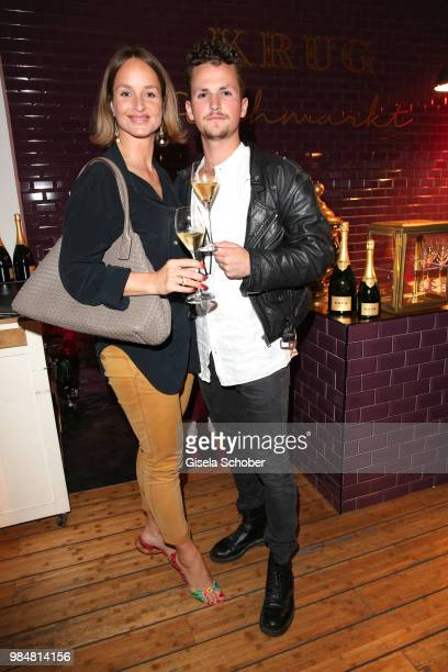 Lara Joy Koerner and her son David Vicedomini Koerner during the opening of the first Krug Fischmarkt pop up fish restaurant on June 26 2018 in...