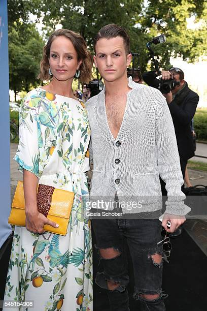 Lara Joy Koerner wearing a dress by Iris von Arnim and her son David Vicedomini during the Iris von Arnim by Unuetzer launch party of the cashmere...