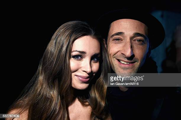 Lara Leito and Adrien Brody pose backstage at the amfAR's 23rd Cinema Against AIDS Gala at Hotel du CapEdenRoc on May 19 2016 in Cap d'Antibes France