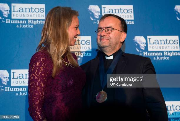 Lara Logan chief foreign affairs correspondent for CBS News presents Father Patrick Desbois with the Lantos Human Rights Prize during a ceremony on...