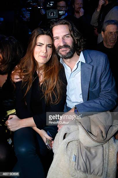 Lara Micheli and her companion Frederic Beigbeder attend the ETAM show as part of the Paris Fashion Week Womenswear Fall/Winter 2015/2016 Held at...