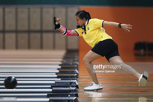 Lara Posadas of the Philippines bowls during the women's doubles bowling on day six of the 2011 Southeast Asian Games at Arena Bowling Jaya Ancol on...