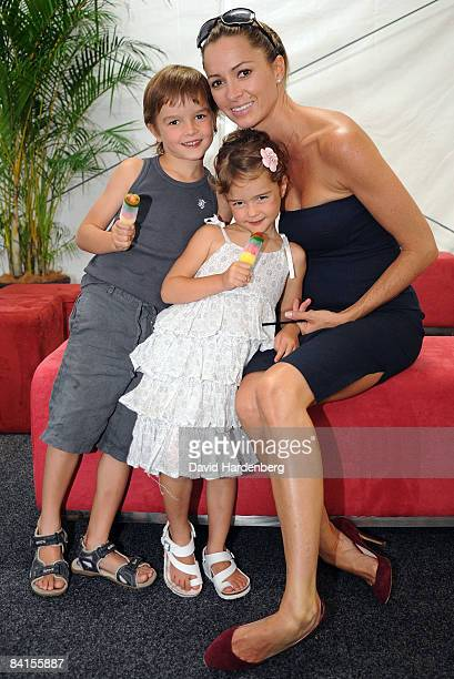 Lara Rafter poses with her children Joshua and India during the official launch of the Pat Rafter Arena at the Queensland Tennis Centre on January 2...