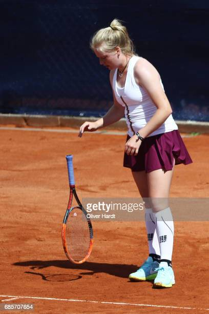 Lara Schmidt of Germany appears frustrated against Aura Sadikovic of Switzerland in the qualification round during the WTA Nuernberger...