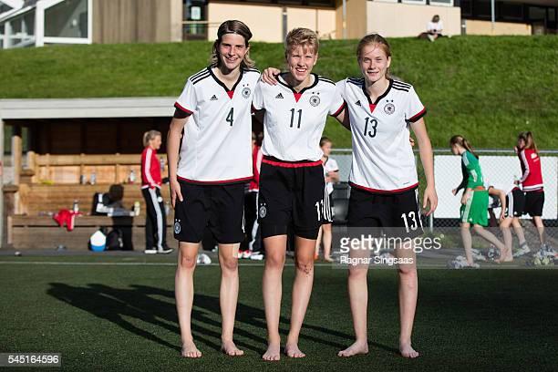 Lara Schmidt of Germany Paulina Krumbiegel of Germany and Sjoeke Nusken of Germany pose for photographs after the Nordic Cup game between U16 Girl's...