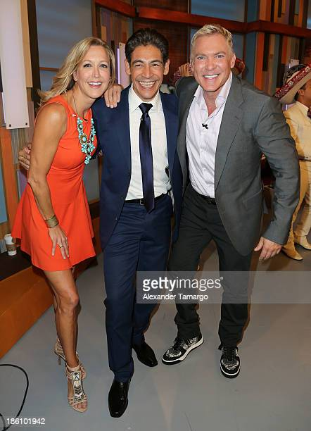 Lara Spencer Johnny Lozada and Sam Champion are seen on the set of Despierta America for simulcast with Good Morning America and Fusion's the Morning...
