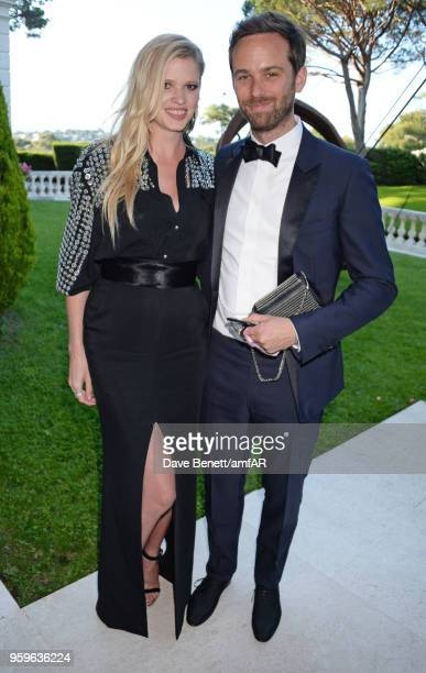 Lara Stone and David Grievson arrive at the amfAR Gala Cannes 2018 at Hotel du Cap-Eden-Roc on May 17, 2018 in Cap d'Antibes, France.