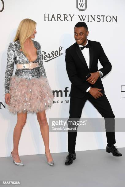 Lara Stone and Sunnery James arrive at the amfAR Gala Cannes 2017 at Hotel du CapEdenRoc on May 25 2017 in Cap d'Antibes France