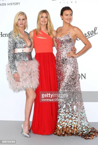 Lara Stone Doutzen Kroes and Irina Shayk arrive at the amfAR Gala Cannes 2017 at Hotel du CapEdenRoc on May 25 2017 in Cap d'Antibes France