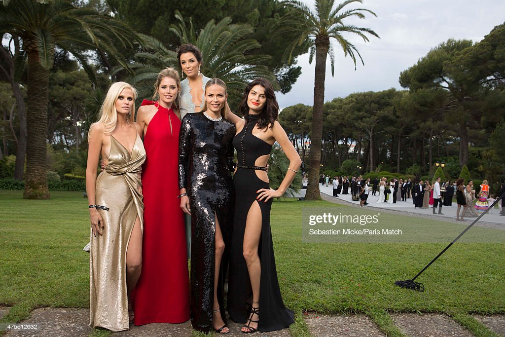 Lara Stone, Doutzen Kroes, Eva Longoria, Natasha Poly and Isabeli Fontana attend the 22nd Gala for AmFar Cinema Against AIDS. Photographed for Paris Match at the Cap-Eden-Roc hotel on May 21, 2015 in Cap d'Antibes, France.