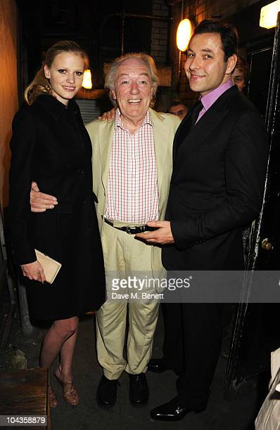 Lara Stone poses with Michael Gambon and David Walliams at the press night of 'Krapp's Last Tape' at the Duchess Theatre on September 22 2010 in...