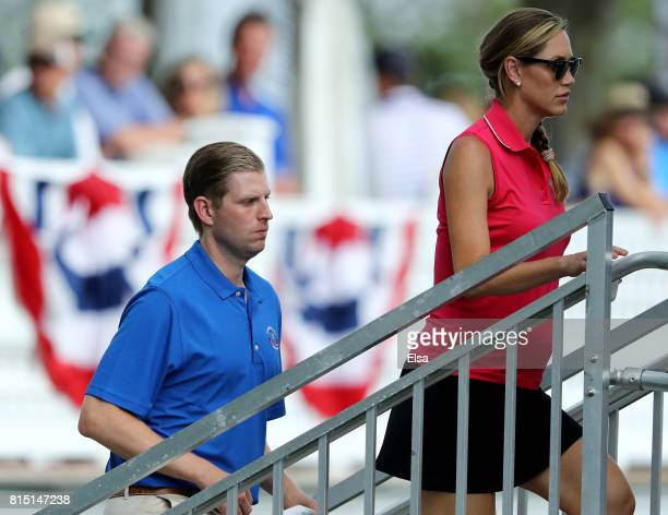 Lara Yunaska and her husband Eric Trump head into US President Donald Trump's suite during the US Women's Open round three on July 15 2017 at Trump...