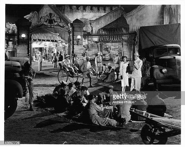 Laraine Day and Barry Nelson having a discussion about his drivers in a scene from the film 'A Yank On The Burma Road' 1942