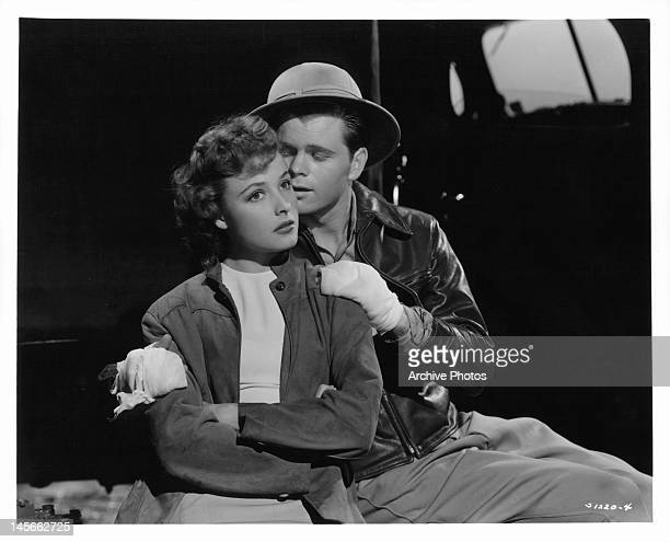 Laraine Day is held by Barry Nelson in a scene from the film 'A Yank On The Burma Road', 1942.