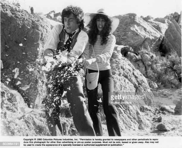 Laraine Newman and Dudley Moore react in a scene for the movie Wholly Moses circa 1980