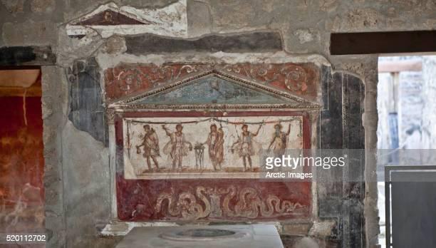 Lararium (shrine) fresco in atrium of ancient tavern, Pompeii, Italy