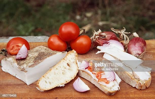 Lard di Colonnata with bread tomatoes and onions Colonnata Tuscany Italy