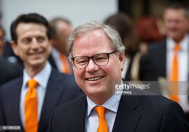 Lard Friese chief executive officer of NN Group NV center arrives outside the Euronext Exchange ahead of the group's IPO in Amsterdam Netherlands on...