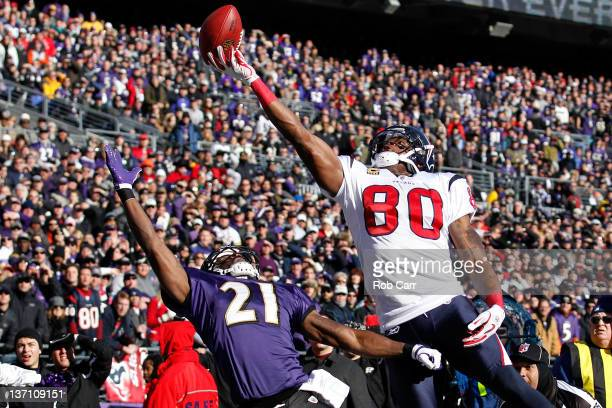 Lardarius Webb of the Baltimore Ravens and Andre Johnson of the Houston Texans reach for an incomplete pass during the second quarter of the AFC...