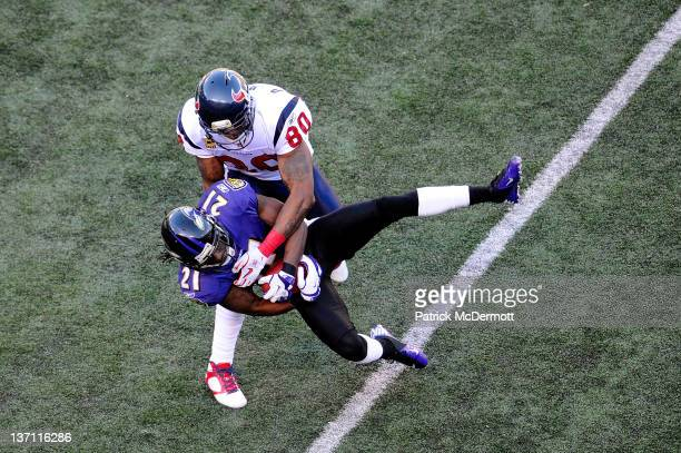 Lardarius Webb of the Baltimore Ravens intercepts a pass intended for Andre Johnson of the Houston Texans during the first half of the AFC Divisional...