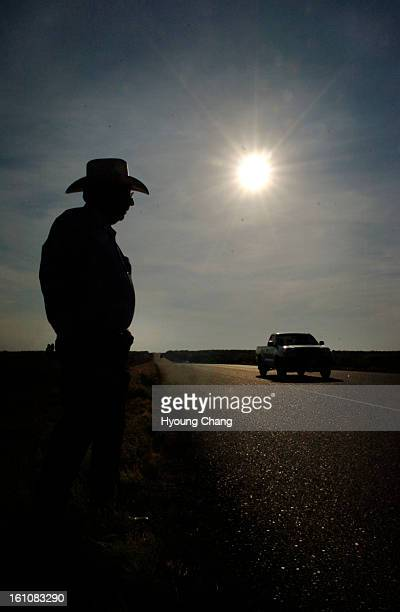 Laredo TX March 24 2006 Ranch owner Adolph Puig stands between Camino Colombia toll road and his ranch on Thursday On January 30 the Texas...