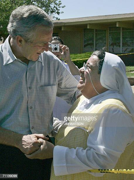 US President George W Bush greets Sister Carmen Palicios during an unscheduled stop at in Laredo TX 06 June 2006 Bush was in Laredo for a briefing at...
