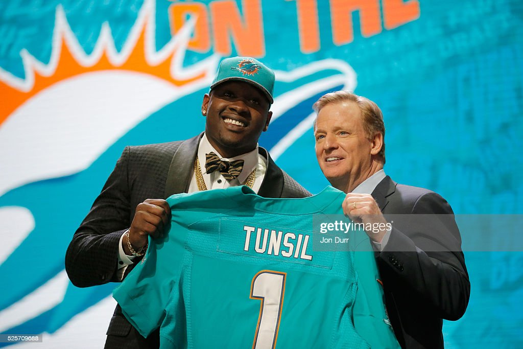 Laremy Tunsil of Ole Miss holds up a jersey with NFL Commissioner Roger Goodell after being picked #13 overall by the Miami Dolphins during the first round of the 2016 NFL Draft at the Auditorium Theatre of Roosevelt University on April 28, 2016 in Chicago, Illinois.