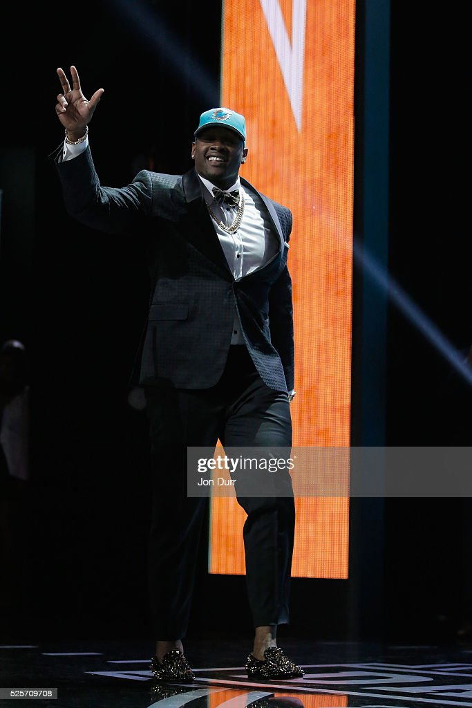 Laremy Tunsil of Ole Miss walks on stage after being picked #13 overall by the Miami Dolphins during the first round of the 2016 NFL Draft at the Auditorium Theatre of Roosevelt University on April 28, 2016 in Chicago, Illinois.