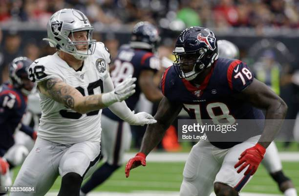 Laremy Tunsil of the Houston Texans blocks Maxx Crosby of the Oakland Raiders during the first half at NRG Stadium on October 27 2019 in Houston Texas