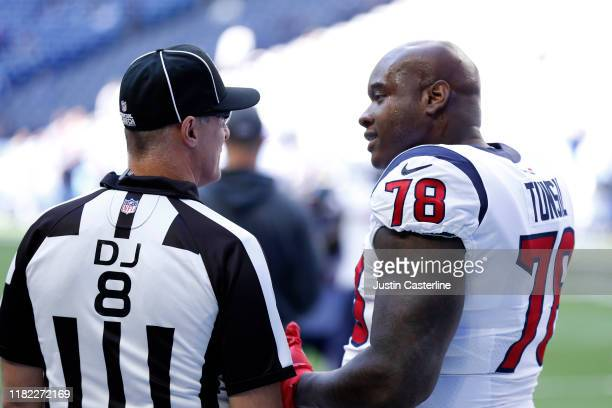 Laremy Tunsil of the Houston Texans talks with line judge Dana McKenzie before the game against the Indianapolis Colts at Lucas Oil Stadium on...
