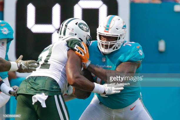 Laremy Tunsil of the Miami Dolphins defends against Brandon Copeland of the New York Jets during an NFL game on November 4 2018 at Hard Rock Stadium...