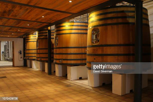 Large 10000 liter oak fermentation tanks await the upcoming harvest at Château Clarke winery on June 25 2018 in ListracMédoc France The Bordeaux...