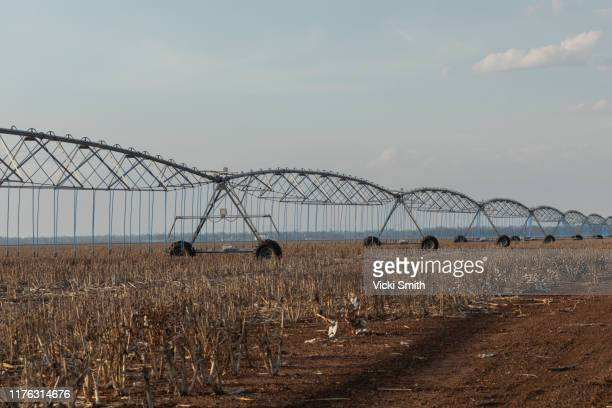 large agricultural irrigation machine used to spray dry crops with water - drought stock pictures, royalty-free photos & images
