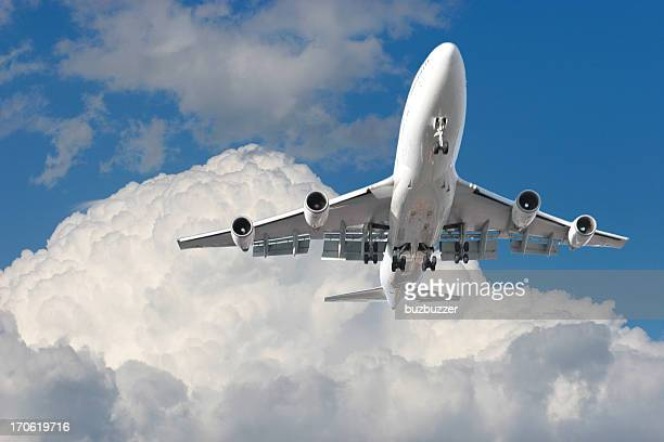 large airplane flying above a cloudy sky - fuselage stock photos and pictures