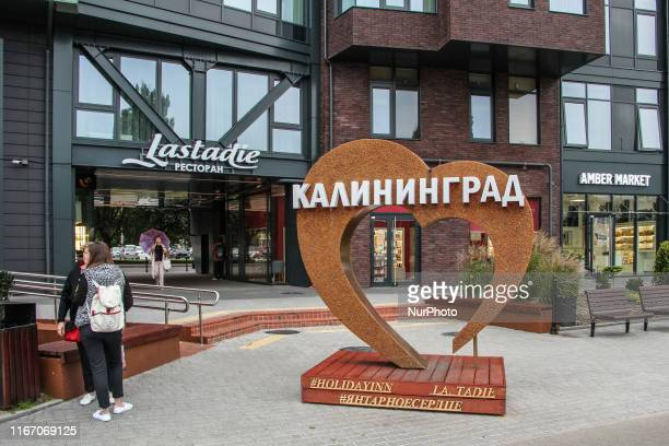 Large amber decorated heart with Kaliningrad inscription outside the Holliday inn hotel is seen in Kaliningrad Russia on 7 September 2019