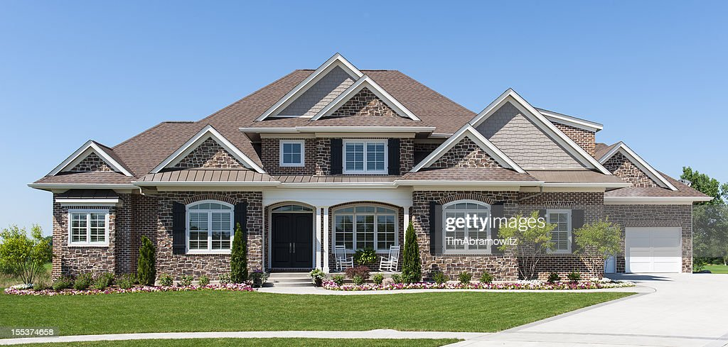 Large American detached home with garden and blue sky : Stock Photo