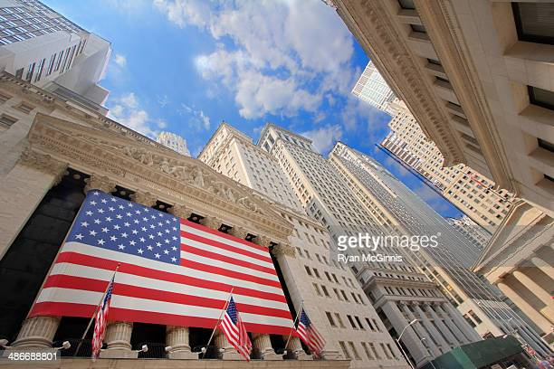 Large American flag at the New York Stock Exchange at Wall Street in New York, New York.