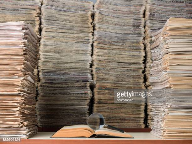 large amount of documents, books and newspapers in library - stack stock photos and pictures