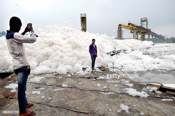 A large amount of foam formed at the banks of river Yamuna on July 12 2015 in Noida India Yamuna in Delhi is almost dead with water not suitable for...