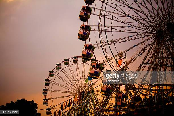 Large amusement park with two giant wheels
