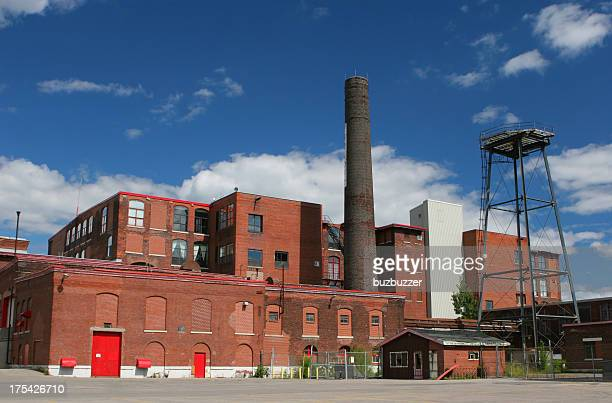 large and old brick industrial building - abandoned stock pictures, royalty-free photos & images