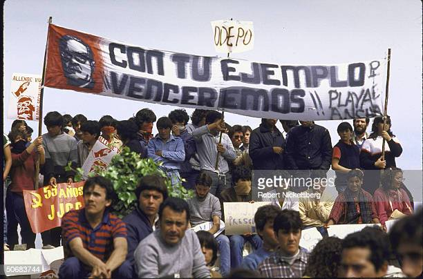 Large and small flags held up by Chile Law School students at antiAugusto Pinochet government/prodeposed leader Allende Salvador demonstrations on...